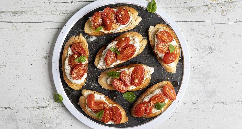 Ricotta and cherry tomato confit bruschetta by the Greek chef Akis Petretzikis