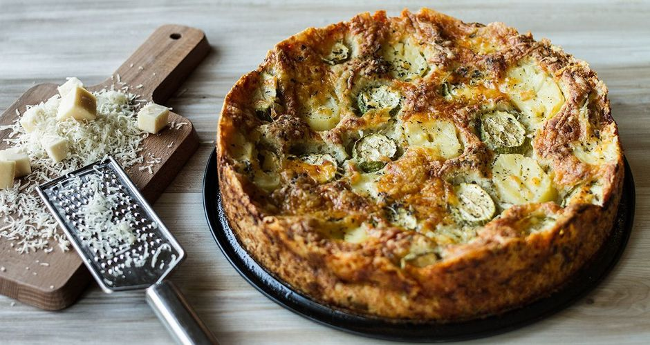 Open-faced potato, zucchini and cheddar pie