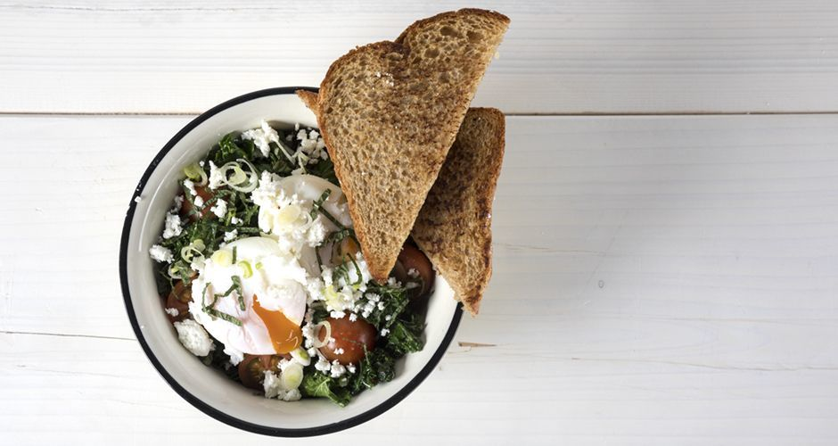 Kale poached egg and cherry tomato salad