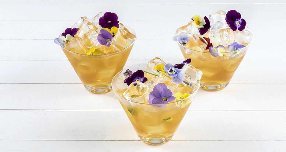 Ginger cordial with edible flowers