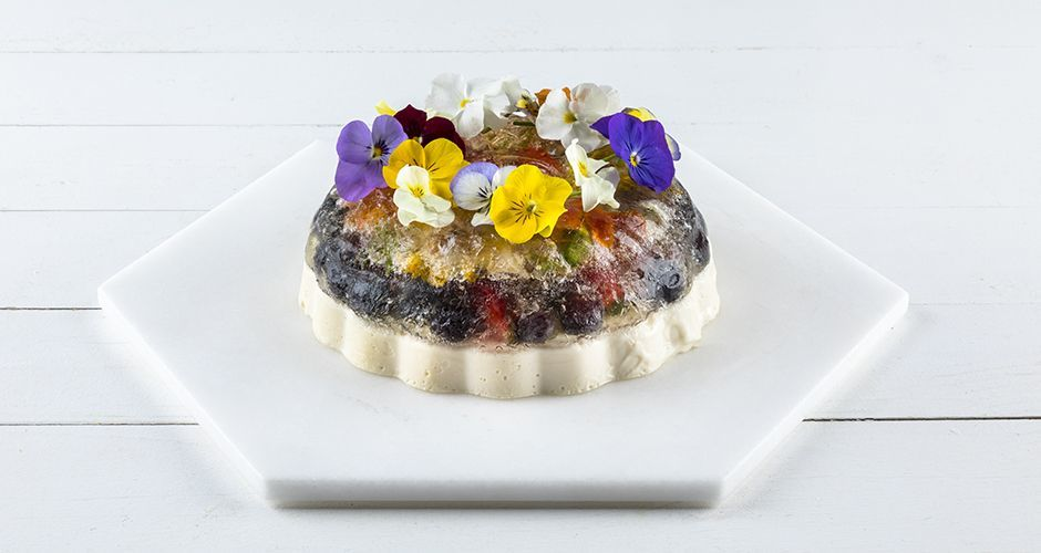 Jello with edible flowers and fruit
