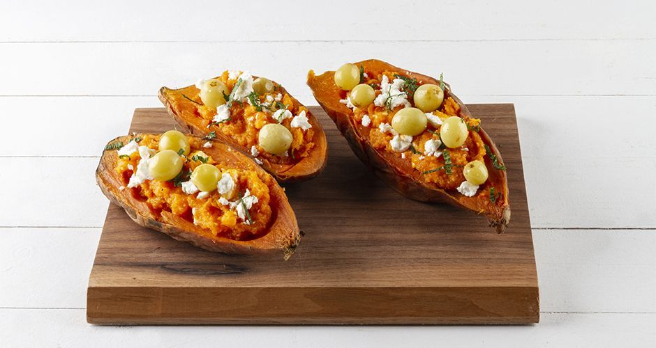 Roasted sweet potatoes with feta cheese and grapes