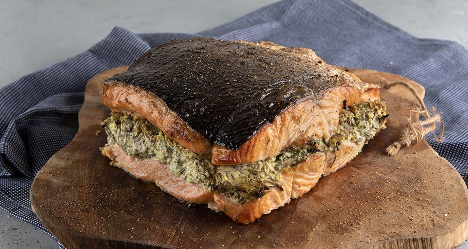 Herb-stuffed roasted salmon