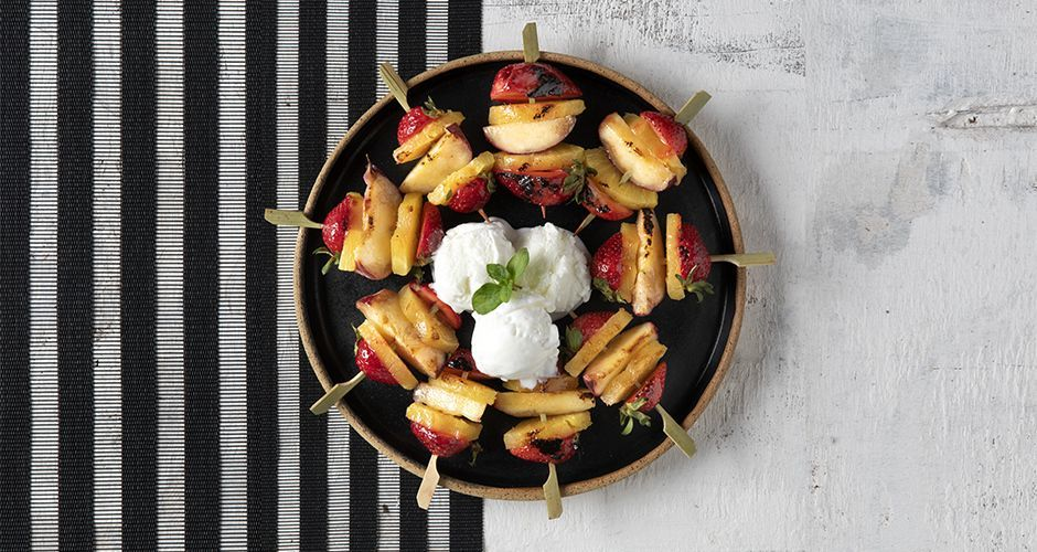 Grilled fruit skewers with homemade vanilla ice cream