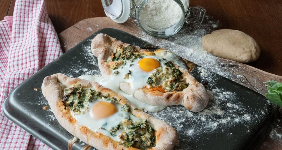 Spinach feta and egg pizza boats