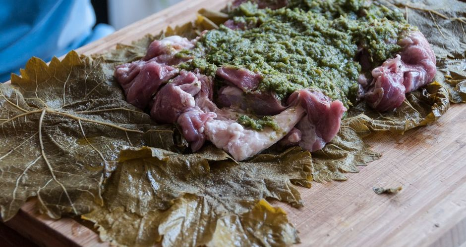 Pesto Stuffed Leg of Lamb Wrapped in Vine Leaves