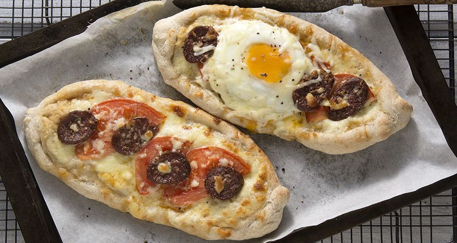 Pizza boat with soutzouki and eggs